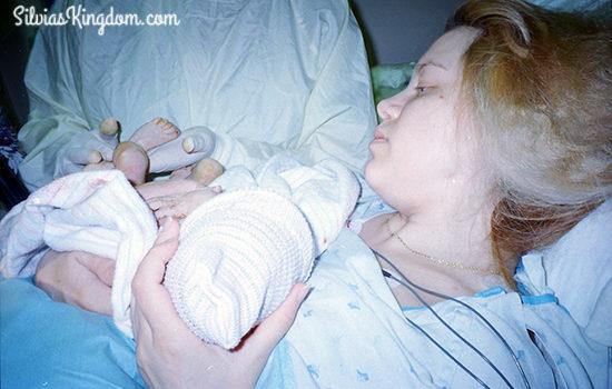 The Nurse showing me Alex's perfect little foot.